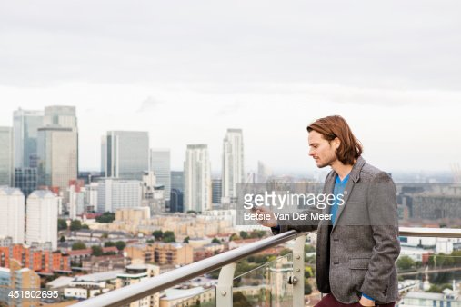 Man looking at mobilephone, elevated city view. : Stock Photo