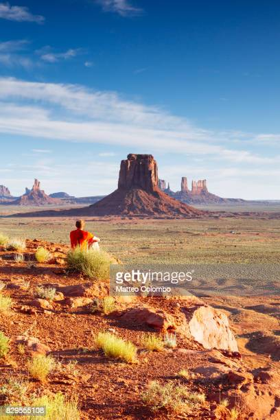 Man looking at Moument valley at sunrise, USA