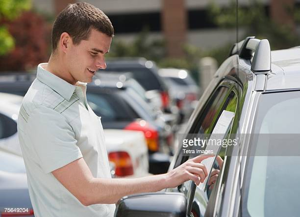 Man looking at new car