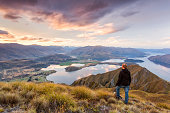 Man looking at scenic landscape, New Zealand