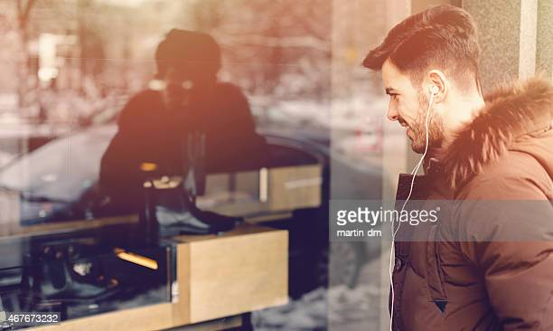Man looking at shoes on the shop window