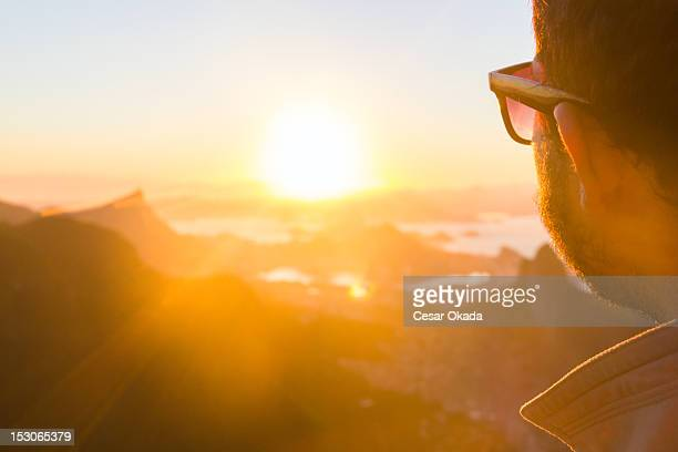 Man looking at sunrise in Rio de Janeiro