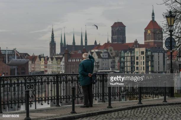 Man looking at the Old town of Gdansk near the WWII museum is seen on 23 March 2017 in Gdansk Poland World War II Museum the biggest of its kind in...
