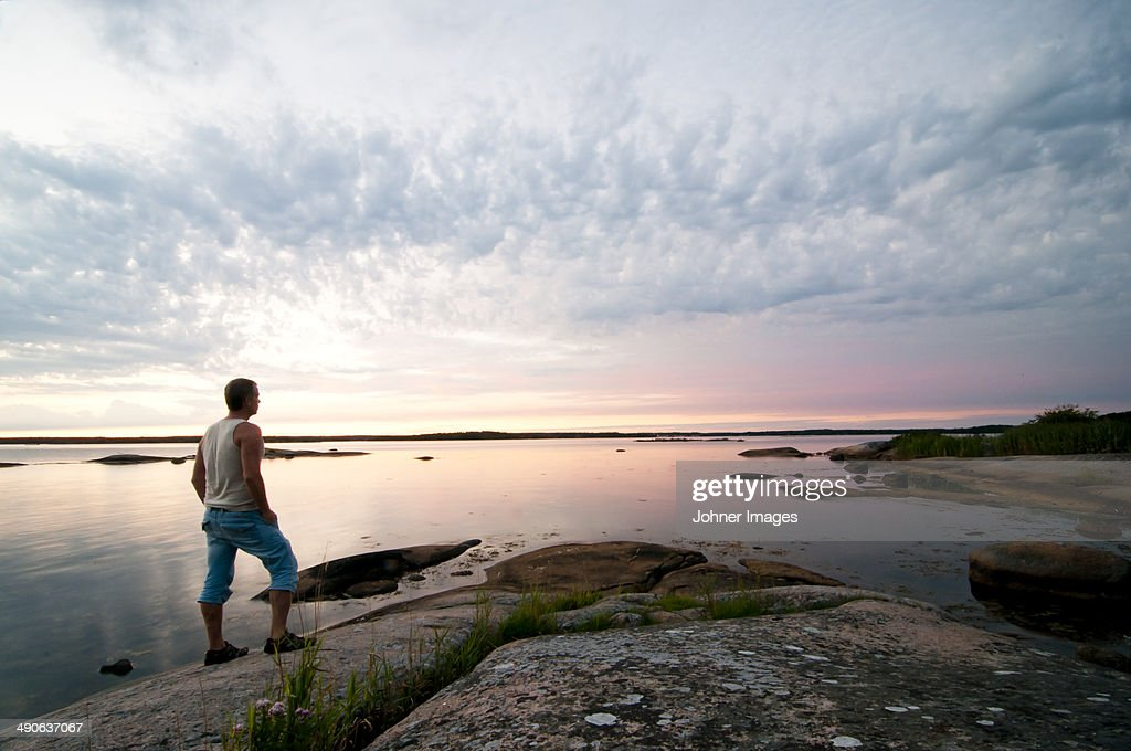Man looking at view at sunset, Ronneby, Blekinge, Sweden