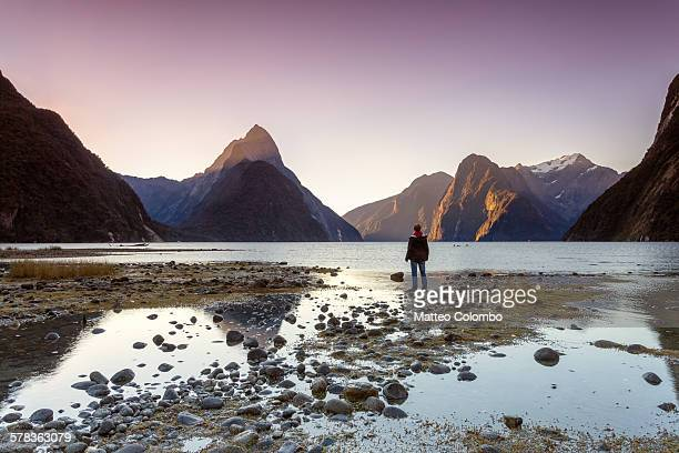 Man looking at view, Milford Sound, New Zealand