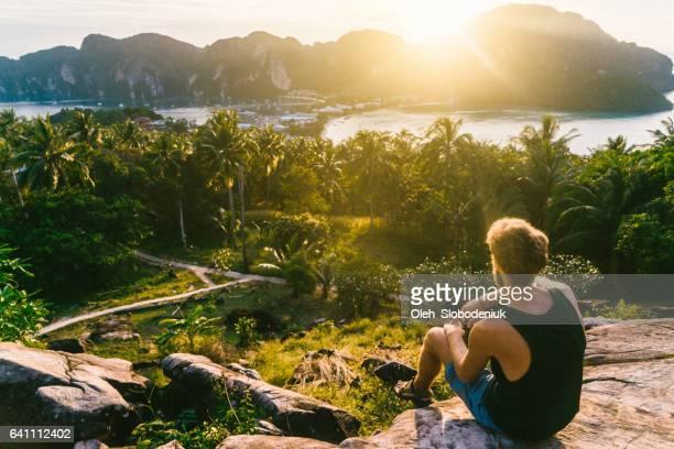 Man looking at view of Koh Phi Phi at sunset