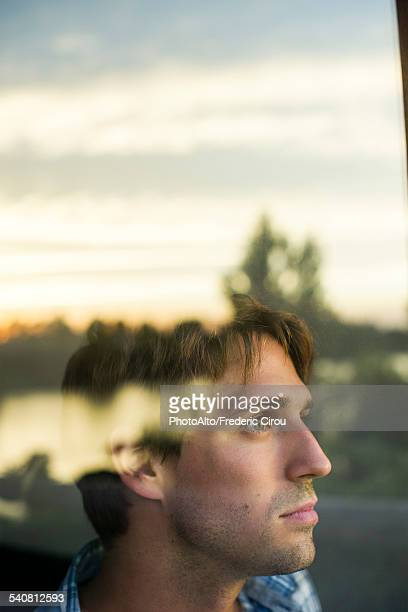 Man looking at view with melancholic air