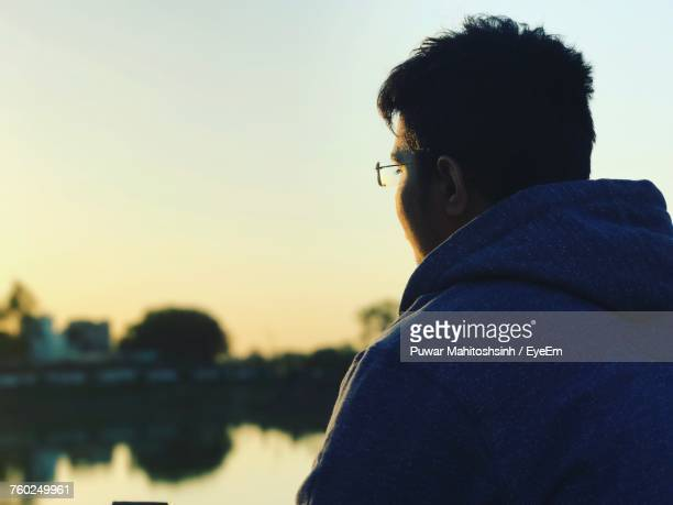 Man Looking Away Against Sky During Sunset