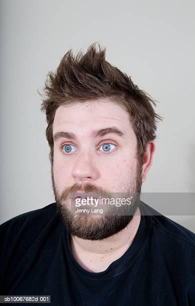 Man looking away, close-up