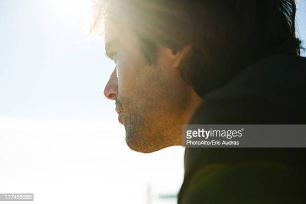 Man looking away in thought
