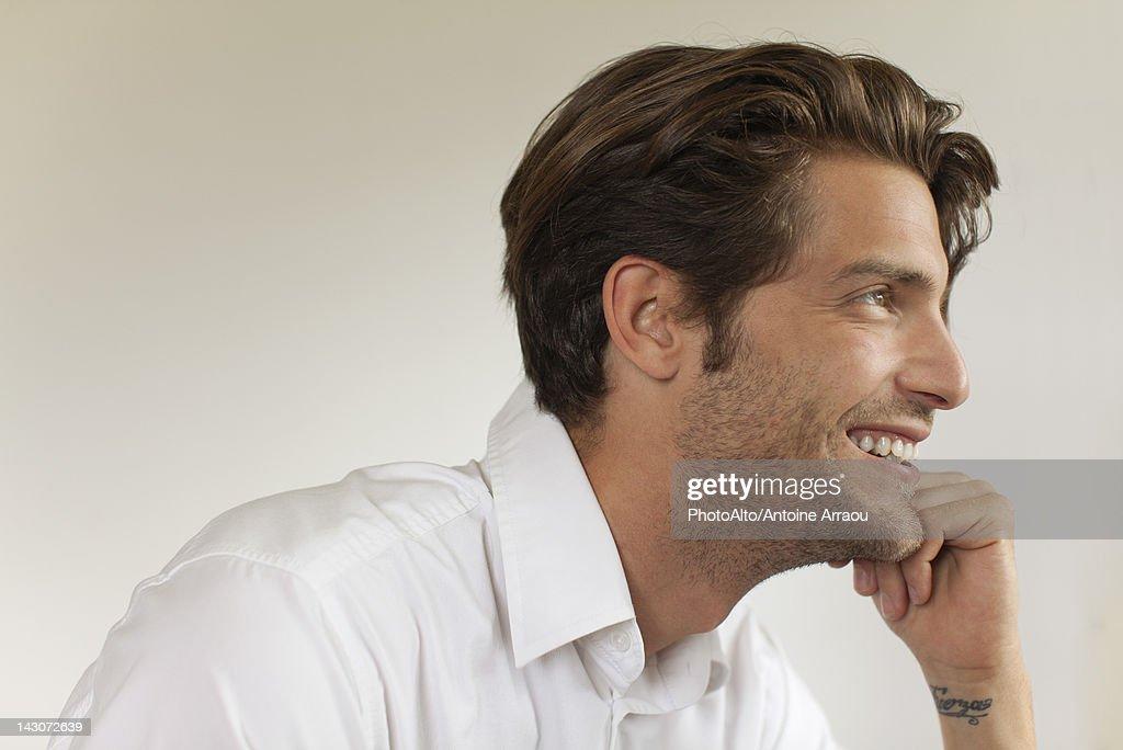 Man looking away, smiling : Stock Photo