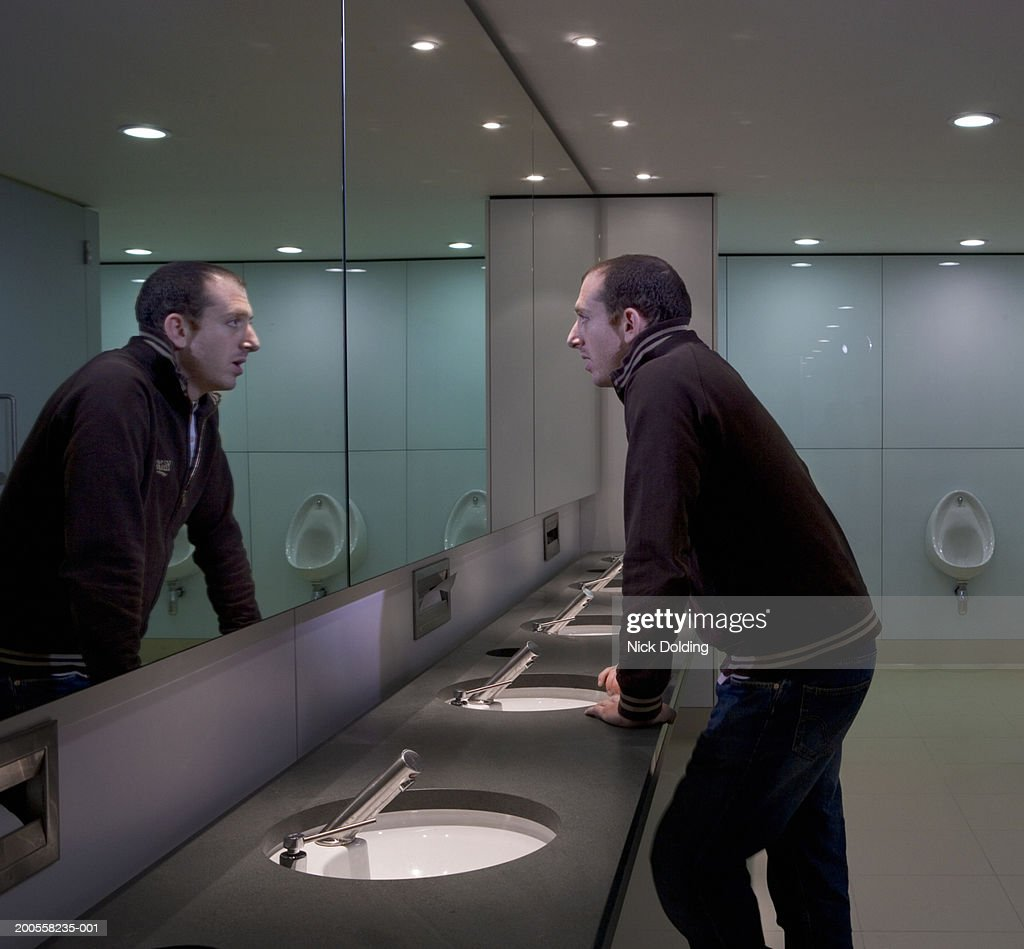Man Looking In Bathroom Mirror Stock Photo Getty Images