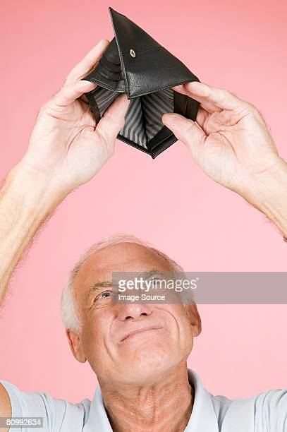 Man looking in empty wallet