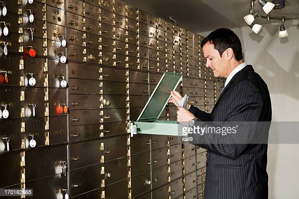 Man looking inside safety deposit box