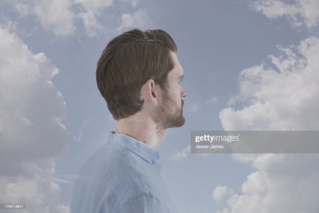 man looking into blue sky and clouds : Stock Photo
