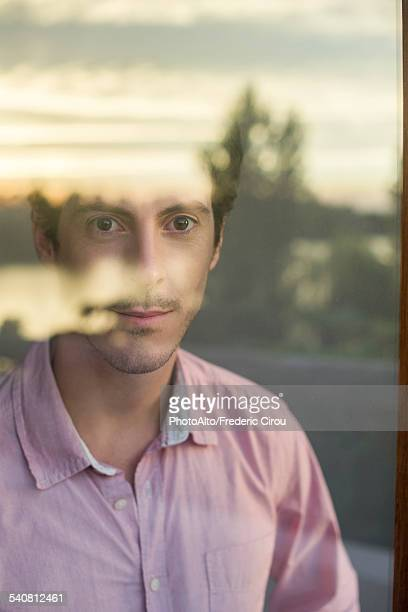 Man looking introspectively at view
