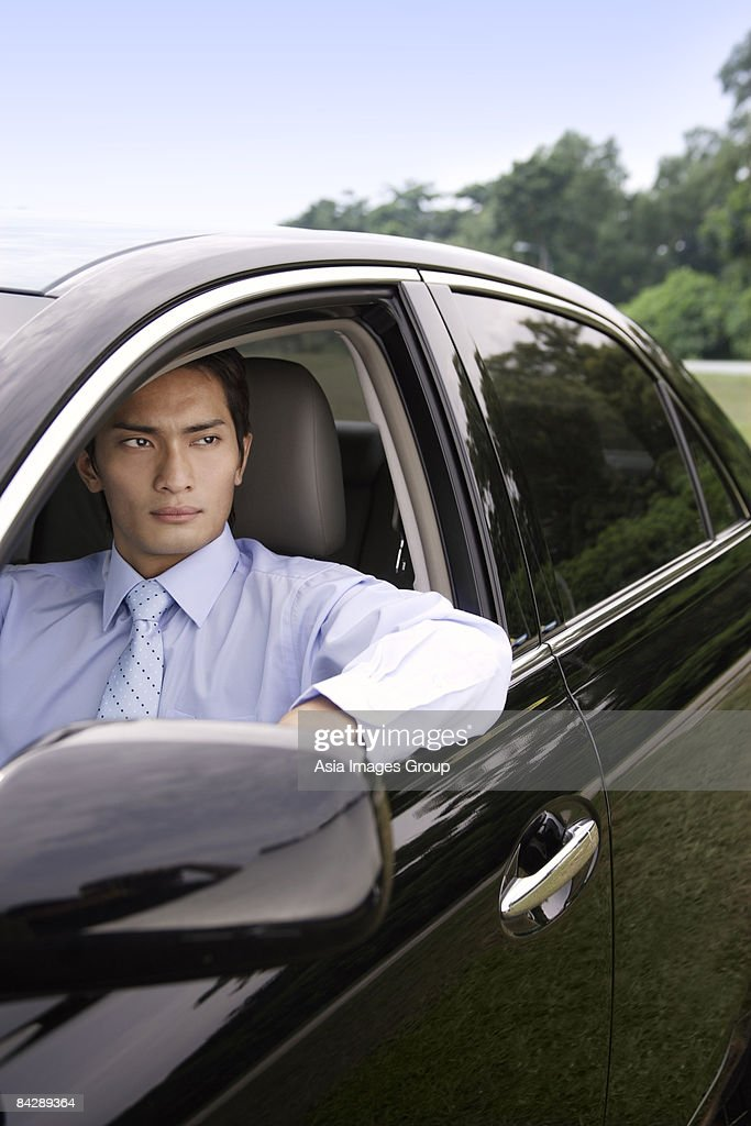 man looking out car window stock photo getty images