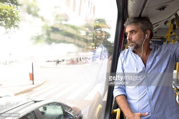 Man looking out of bus window, Rio de Janeiro, Brazil