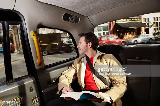 Man looking out of taxi window