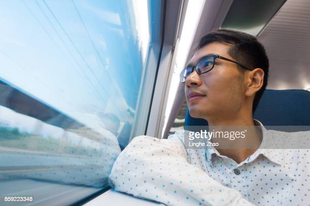 Man looking out of train window