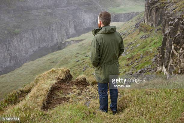 Man looking out over a canyon