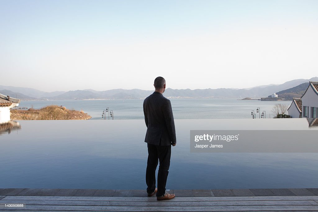 man looking out to lake in ningbo,china : Stock Photo