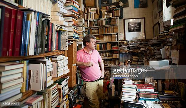 Man looking out window in small bookstore