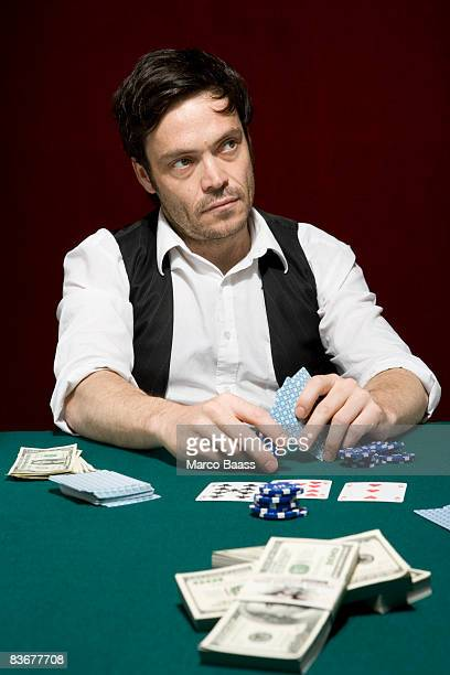 A man looking suspiciously at a high stakes poker game