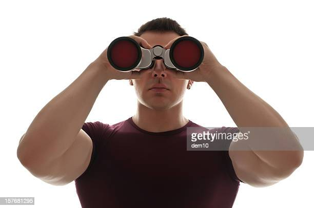 Man looking through a pair of binoculars