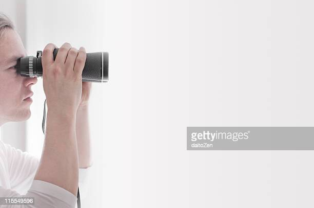 Man looking through binoculars