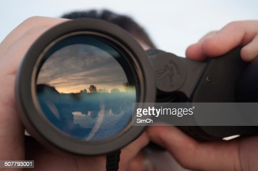 man looking through binoculars : Stock Photo