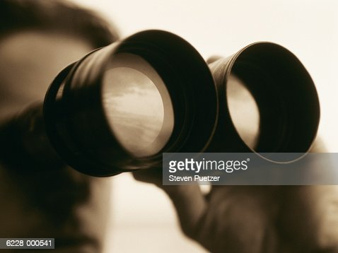 Man Looking through Binoculars : Stock Photo