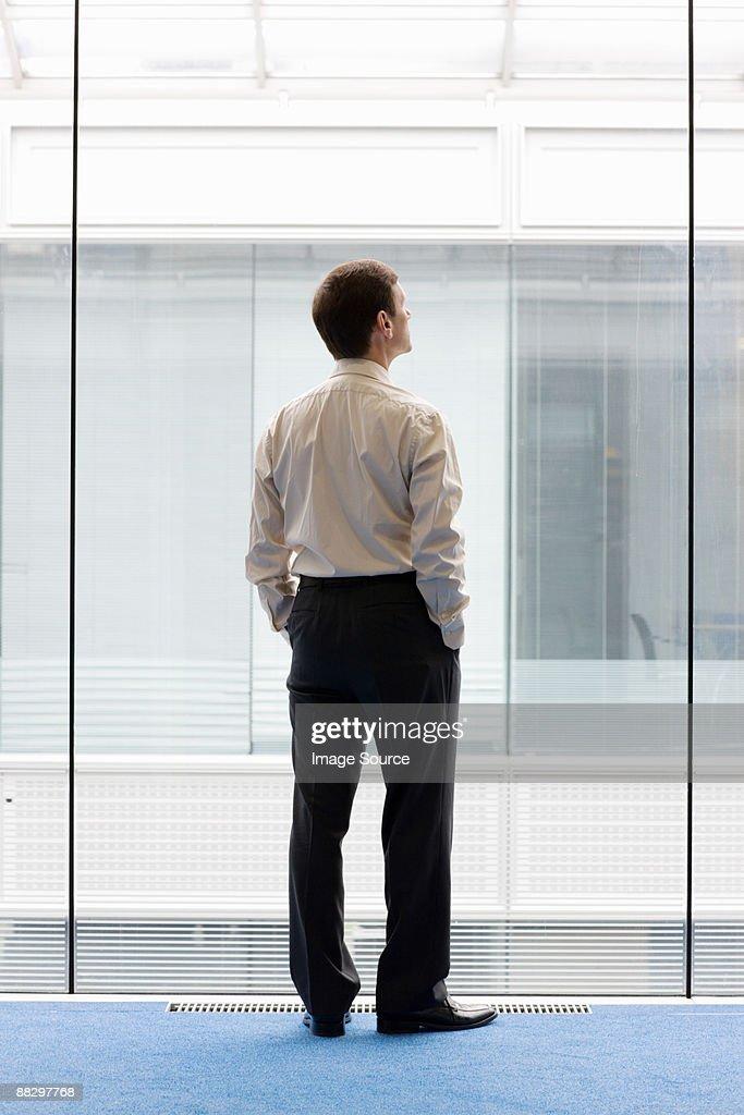 Man looking through window : Stock Photo