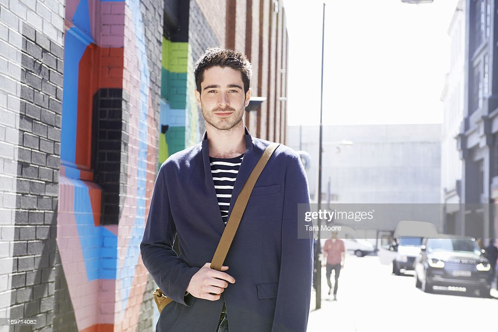 man looking to camera in city