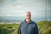Middle aged man looking to camera in rural area, Dublin mountains, Dublin, Ireland.