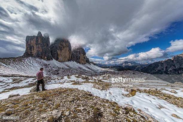 Man looking to great dolomite landscape