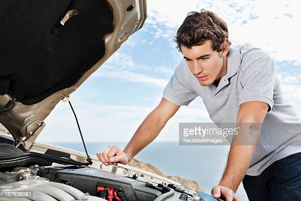 Man Looking Under Hood