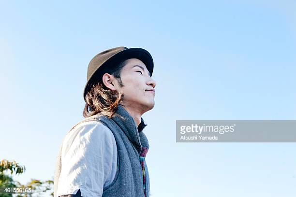 Man looking up at sky,smiling