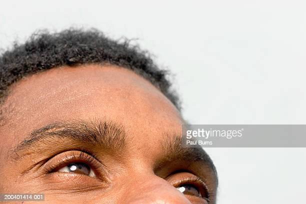 Man looking upward, close-up