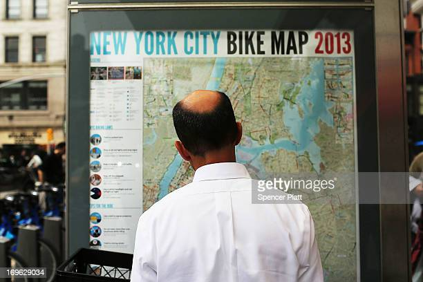A man looks at a bicycle map at a Citi Bike docking station in Union square on May 29 2013 in New York City Citi Bike the long awaited bike sharing...