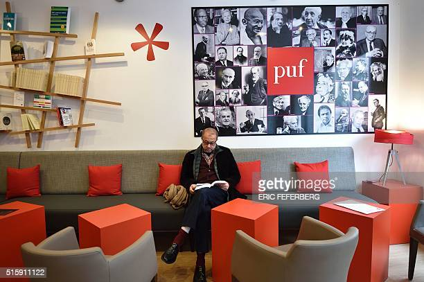 A man looks at a book before printing out his own copy at the new bookstore of the Presses Universitaires de France in Paris on March 16 2016 17...