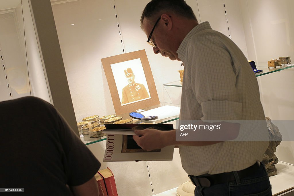 A man looks at a catalog next to a lock of hair from Emperor Franz Joseph I of Austria prior to an auction of Imperial Court Memorabilia and Historical Objects at the Palais Dorotheum in Vienna on April 25, 2013. The lock of hair was sold for 11,000Euros.
