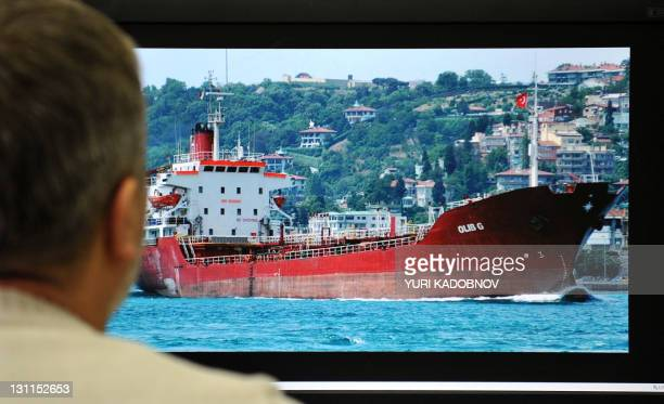 A man looks at a computer monitor desplaying a web page with a photograph of Maltaflagged MV Olib G cargo ship in Moscow on November 2 2011 15...
