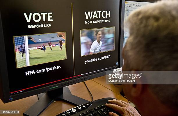A man looks at a computer screen displaying the FIFA web page where people from around the globe can vote their favorite candidate for the Puskas...