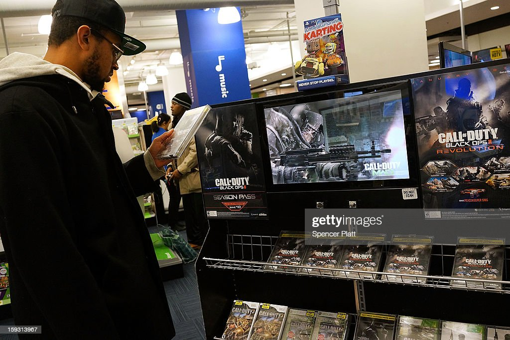 A man looks at a copy of the game Call of Duty Black Ops 2 at an electronics store on January 11, 2013 in New York City. Following the shootings of children at a elementary school last month in Connecticut, numerous politicians and activists have begun to focus on violence in video games and films. US vice-president Joe Biden is meeting with games industry representatives today to discuss graphic violence, often with guns, in many of today's most popular video games. The administration is also expected to address violence in the film industry as well.