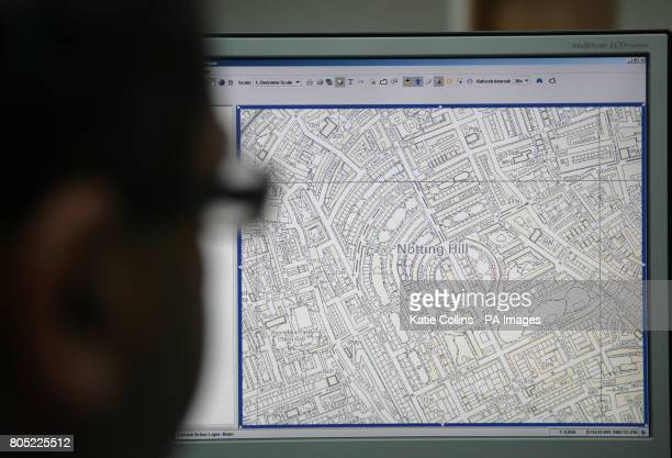 A man looks at a detailed map of Notting Hill at Metropolitan Police's Specialist Operations Room in Lambeth from where the Notting Hill Carnival and...