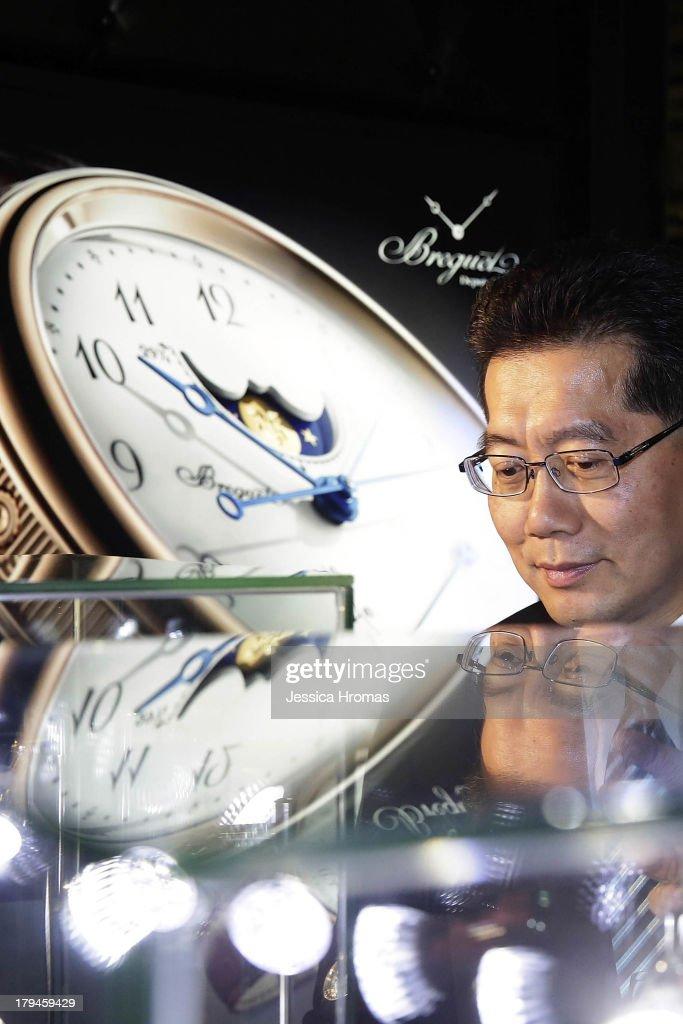 A man looks at a display of luxury watches at the Hong Kong Watch And Clock Fair on September 4, 2013 in Hong Kong, Hong Kong.