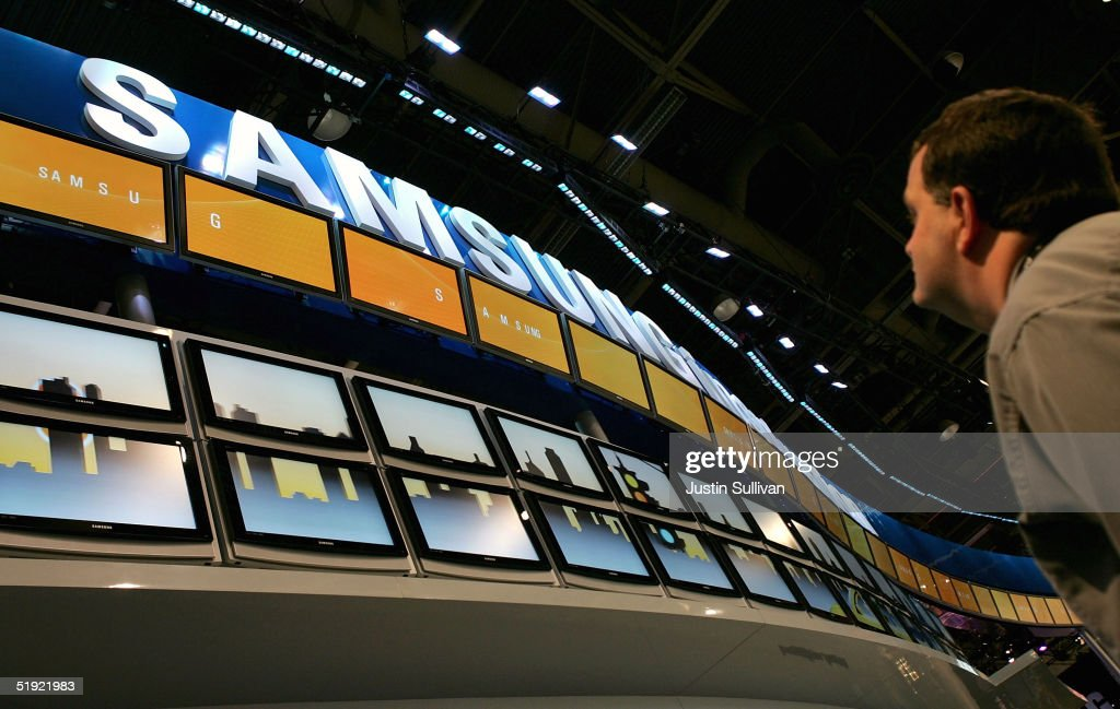 A man looks at a display of Samsung flat panel televisions at the 2005 Consumer Electronics Show January 6, 2005 in Las Vegas, Nevada. The 1.5 million square foot electornic gadget show begins on Thursday and runs through Sunday and is expected to attract over 120,000 attendees.
