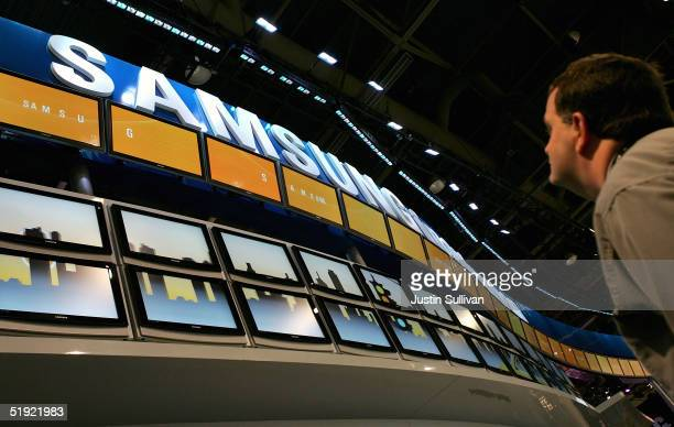 A man looks at a display of Samsung flat panel televisions at the 2005 Consumer Electronics Show January 6 2005 in Las Vegas Nevada The 15 million...