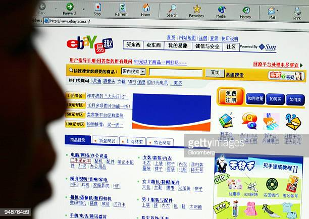A man looks at a EBay Inc's EachNet Chinese online auction website Wednesday October 13 2004 in Shanghai China EBay the world's largest Internet...